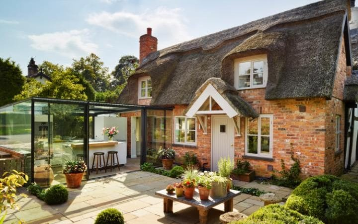 Glass Extension to a thatched cottage