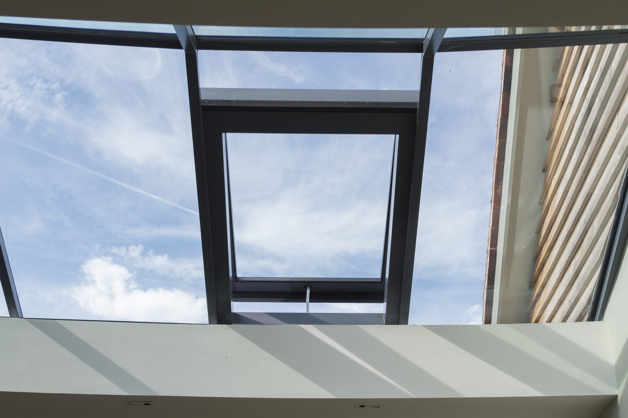 Multi-panel roof light opening section